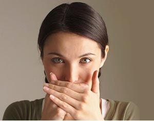 Girl with hand over mouth image